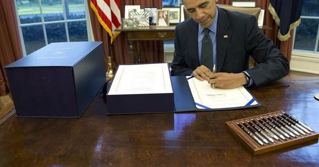 Obama signs $1.1 trillion budget compromise