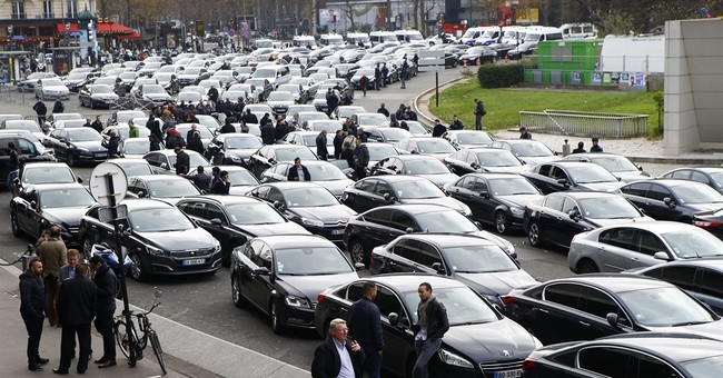 French livery drivers strike against drop in earnings, Uber