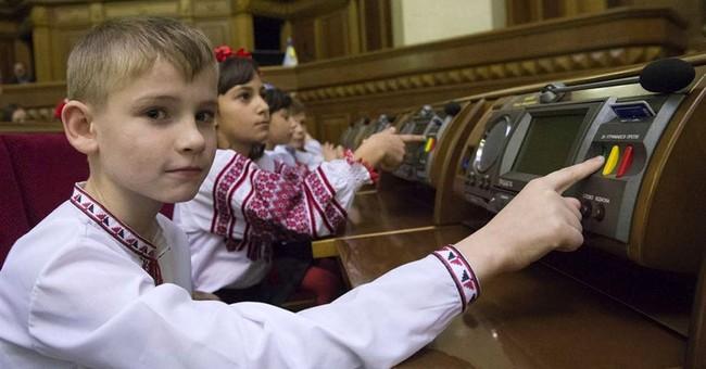 Children take seats at Ukraine's often-rowdy parliament