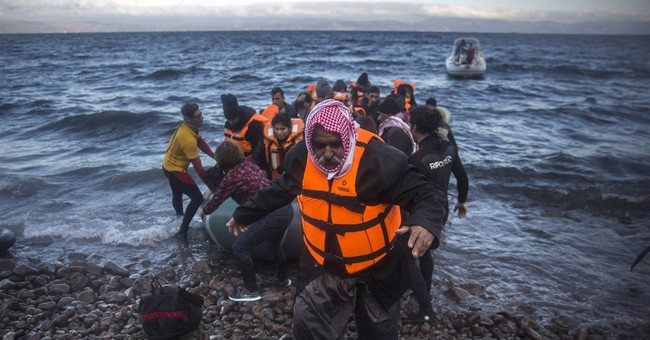 The Latest: Stranded migrants chant 'Open the borders!'