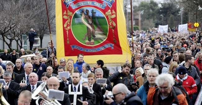 Miners, families march after last British coal mine closes