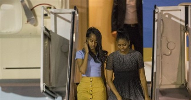 Obama, family back in Hawaii for annual Christmas vacation