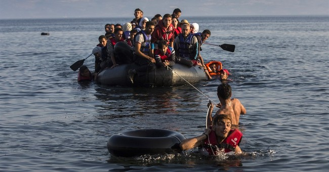 AP PHOTOS: In 2015, Greece stuck in debt and migrant crises