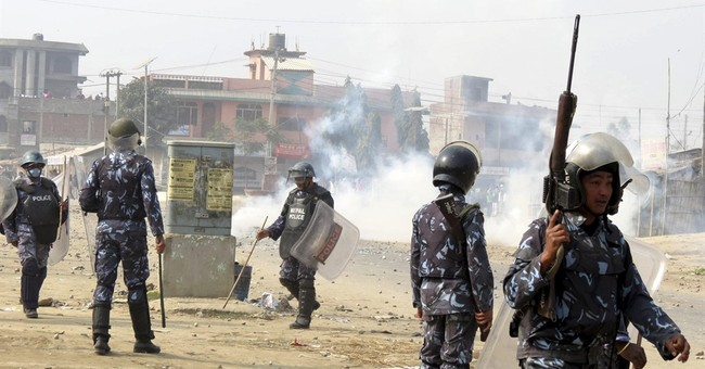 Ethnic protesters, police clash in southern Nepal; 1 dead
