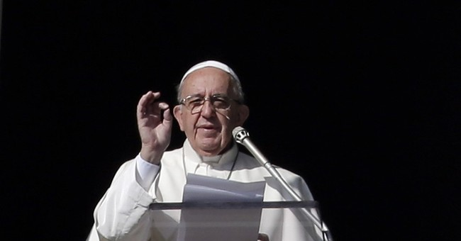 Pope praises diplomatic accords on Libyan, Syrian conflicts