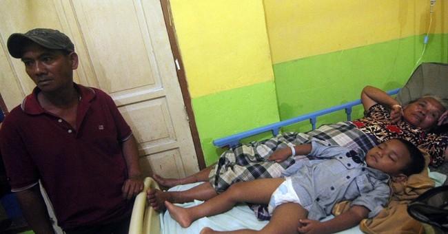 80 missing, 3 dead as big waves sink Indonesia boat