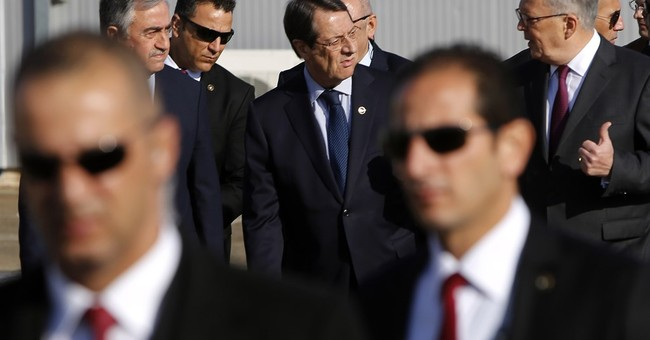 Cyprus leaders determined to solve peace talks difficulties