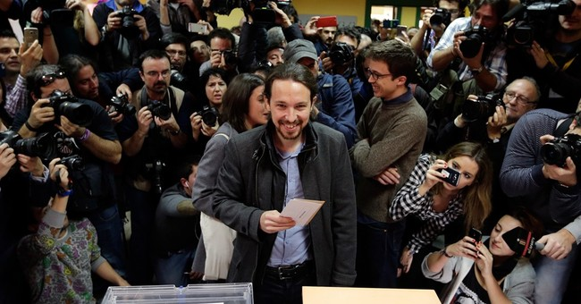 The Latest: Greek PM says austerity defeated in Spain