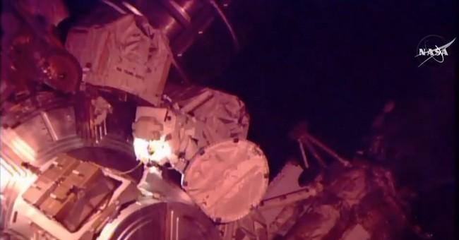 Astronauts help move stalled rail car during spacewalk