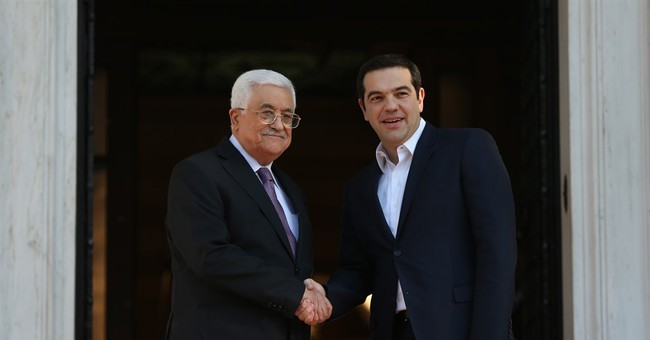 Abbas says new passports will refer to Palestinian state