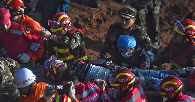 Man found alive after more than 60 hours in China landslide