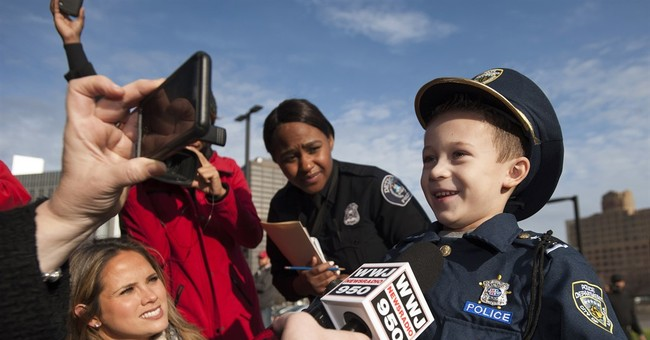 Boy, 7, sworn in as Detroit police chief for a day