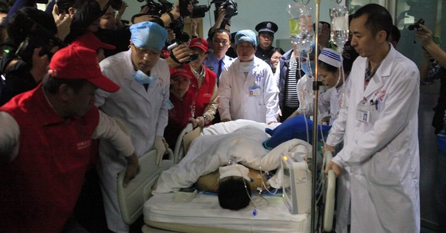 Door panel saves man buried 67 hours in China landslide