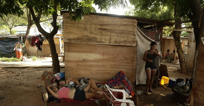 Floods force mass evacuations in 4 South American countries