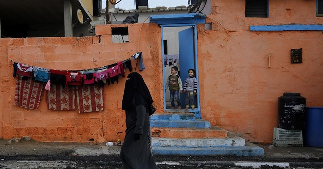 AP PHOTOS: Painters bring new life to hard-hit areas in Gaza