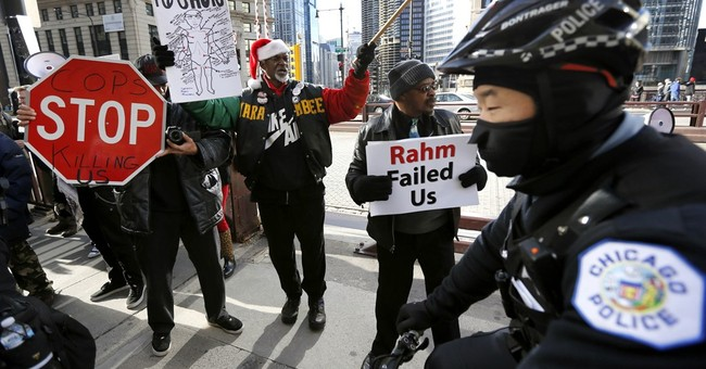 The Latest: Police detain 2 after scuffle at Chicago protest