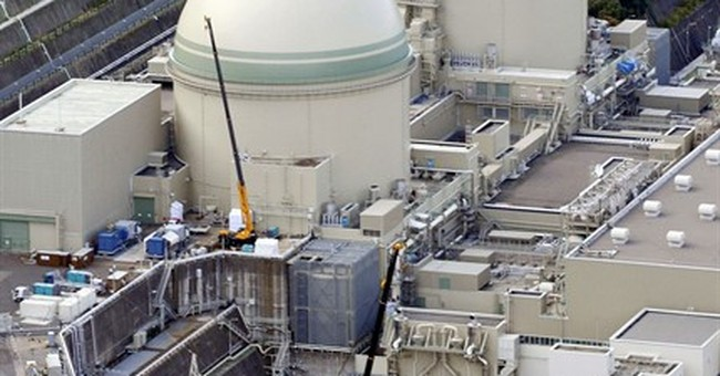 Japan court gives go-ahead for restart of 2 nuke reactors