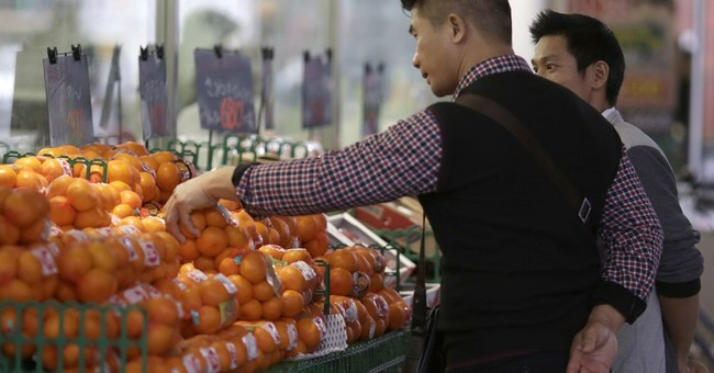 Japan inflation edges up in Nov, but spending, wages fall