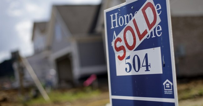Defying Fed hike, 30-year mortgage rate slips to 3.96 pct.