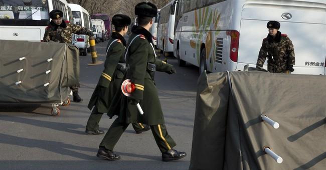 Beijing tightens security as embassies warn of threats