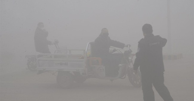 More Chinese cities issue red alerts for heavy smog