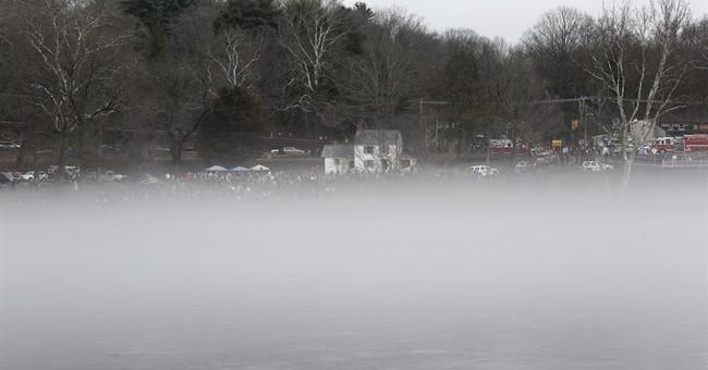 George Washington re-enactors cross the Delaware River