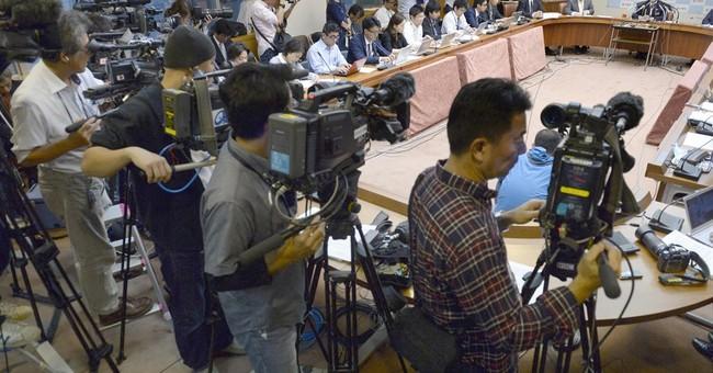Okinawa sues Tokyo in bid to stop move of US Marine air base