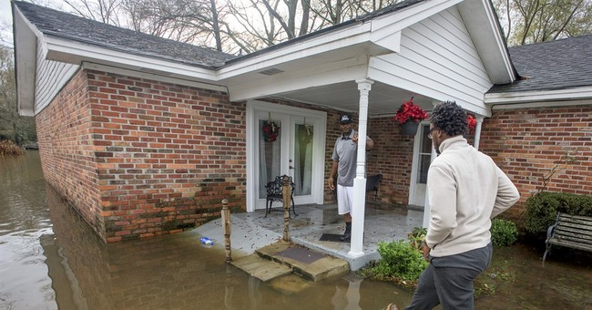 The Latest: Alabama pastor finds church collapsed in storm