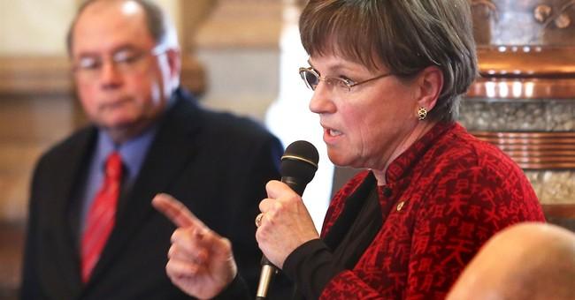Kansas moves to close budget shortfall following tax cuts