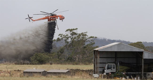 Christmas wildfire destroys more than 100 homes in Australia