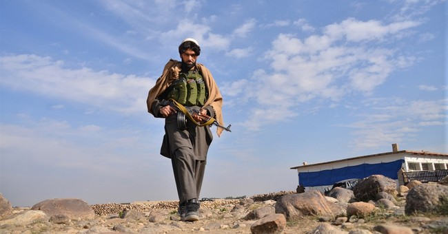 Afghan official: IS, militia brutally kill other's fighters