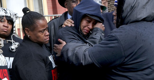The Latest: Lawsuit filed in Chicago police shooting