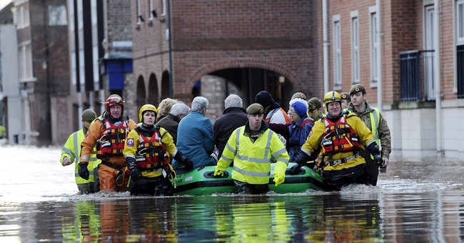 UK military helps combat flooding as it spreads to cities