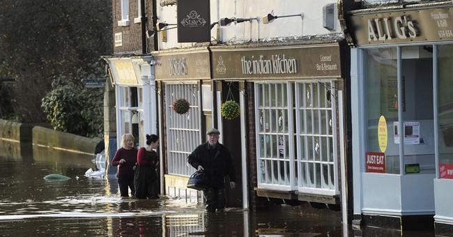 UK's Cameron: More money to be spent on flood defenses