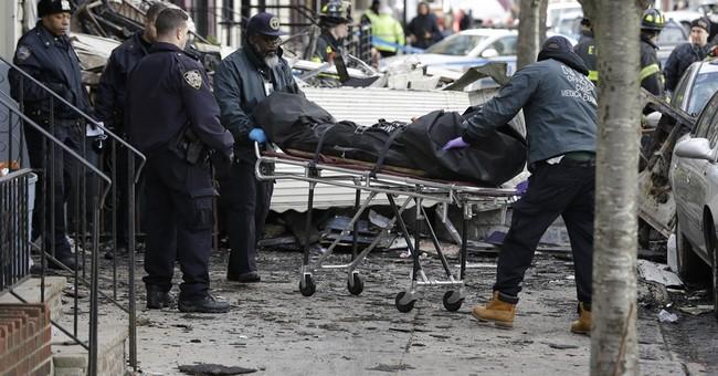 Fire kills 2 as it tears through Brooklyn apartment building