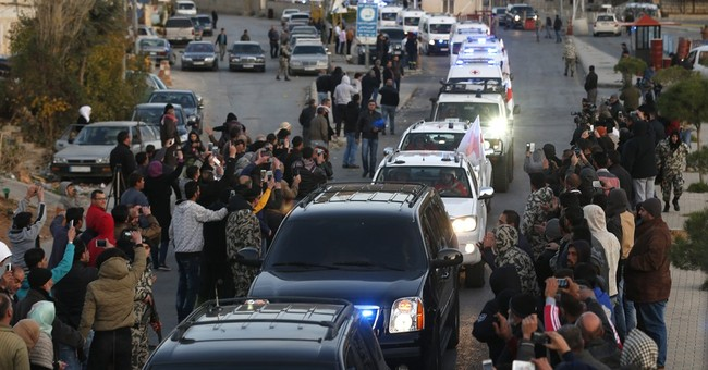 Wounded fighters, civilians evacuated from Syria