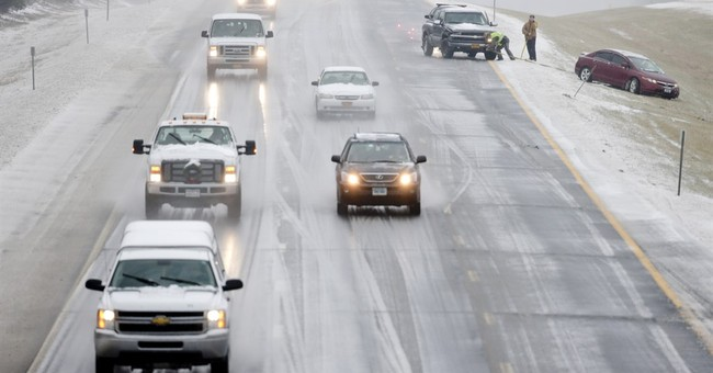 The Latest: Man pulls unloaded gun on snow plow driver