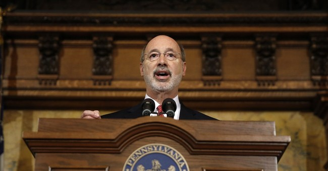 Wolf vetoes part of budget, but releases cash for schools