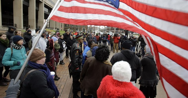 The Latest: Tamir Rice protest blocking traffic downtown
