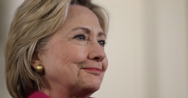 Clinton calls IS killings of Christians, Yazidis 'genocide'