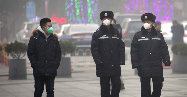 China detains 2 men for spreading terrorist rumor