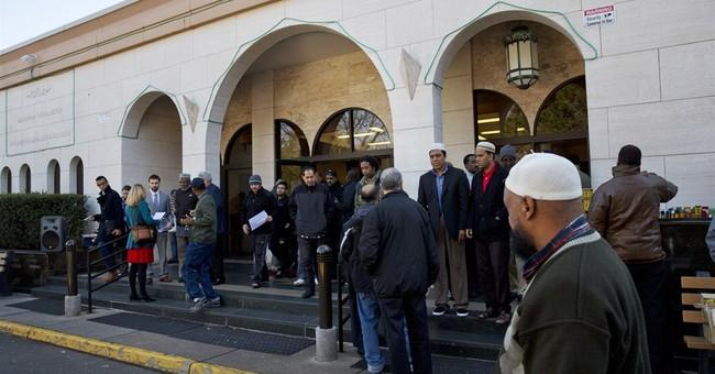 AP-NORC Poll:  Christian-Muslim split on religious freedom