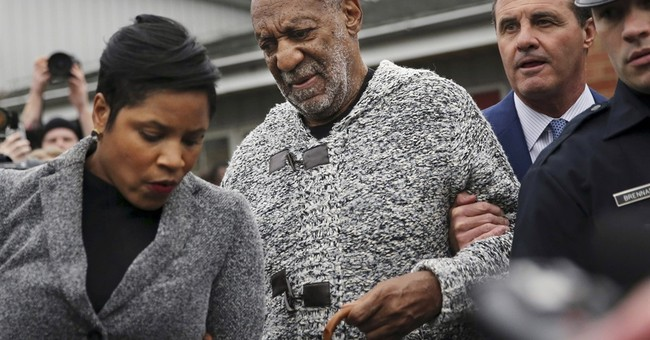 Cosby's sexual assault charge leaves blacks feeling betrayed