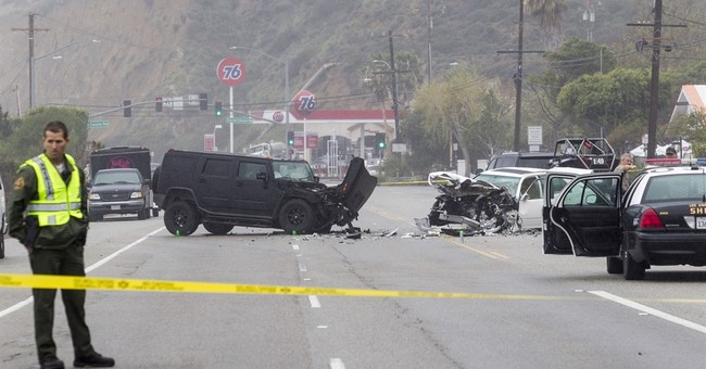 Caitlyn Jenner settles suit by woman injured in deadly crash