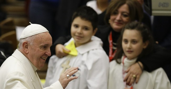 Pope tells young choristers that he sings like a donkey