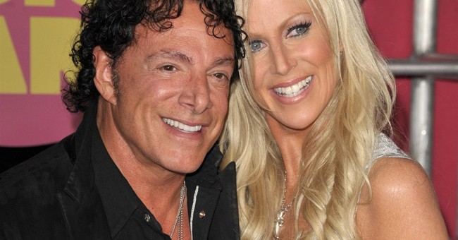 APNewsBreak: Journey guitarist suing over wedding charges