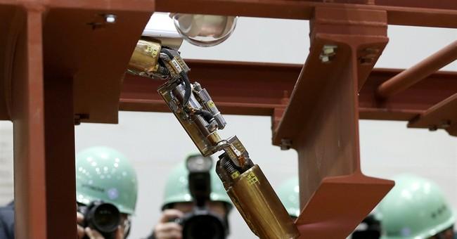 Japan readies first robot to probe melted Fukushima reactor