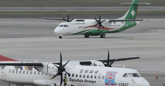 TransAsia gives money to victims' families for funeral costs