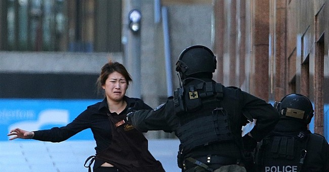 2 hostages say they plotted to stab gunman in Sydney siege