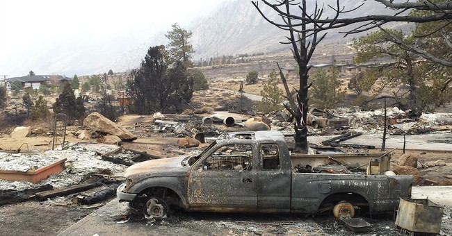 Evacuations remain after wildfire chars California towns